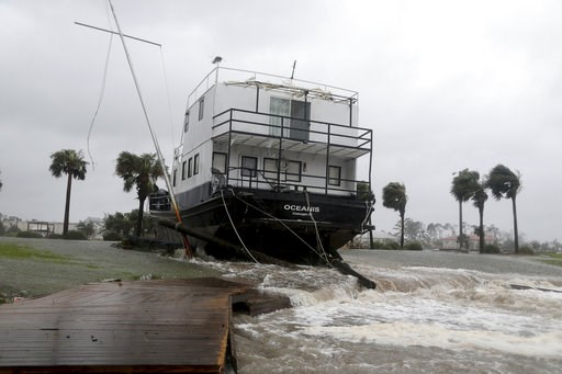 (Douglas R. Clifford/Tampa Bay Times via AP). The Oceanis is grounded by a tidal surge at the Port St. Joe Marina, Wednesday, Oct. 10, 2018 in Port St. Joe, Fla. Supercharged by abnormally warm waters in the Gulf of Mexico, Hurricane Michael slammed in...