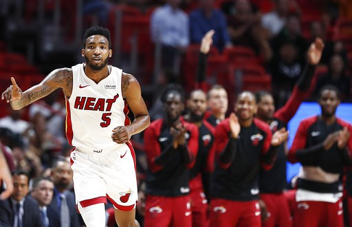 (AP Photo/Brynn Anderson). Miami Heat forward Derrick Jones Jr. and teammates, rear, celebrate after he scored against the New Orleans Pelicans during the first quarter of a preseason NBA basketball game in Miami on Wednesday, Oct. 10, 2018.