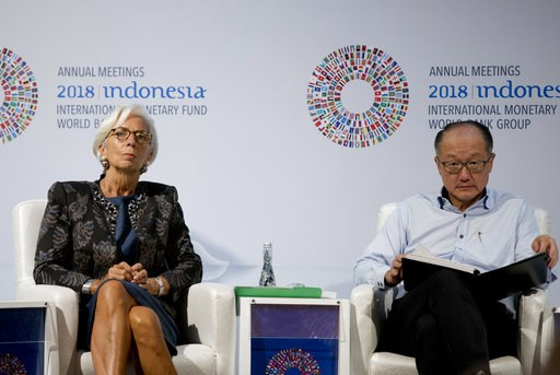 (AP Photo/Firdia Lisnawati). Managing Director of International Monetary Fund (IMF) Christine Lagarde, left, and World Bank President Jim Yong Kim attend a trade conference in Bali, Indonesia Wednesday, Oct. 10, 2018.