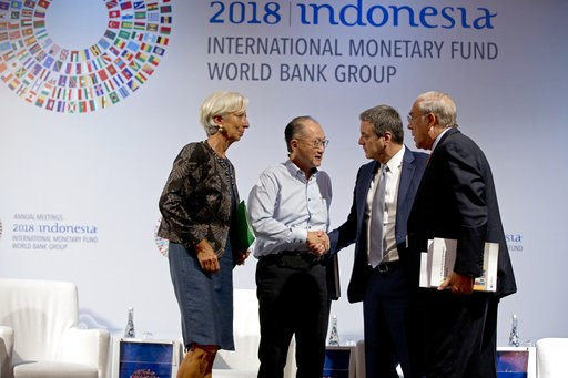 (AP Photo/Firdia Lisnawati). World Bank President Jim Yong Kim, second left, greets Director General of the World Trade Organization Roberto Azevedo, second right, Managing Director of International Monetary Fund (IMF) Christine Lagarde, left, and Secr...