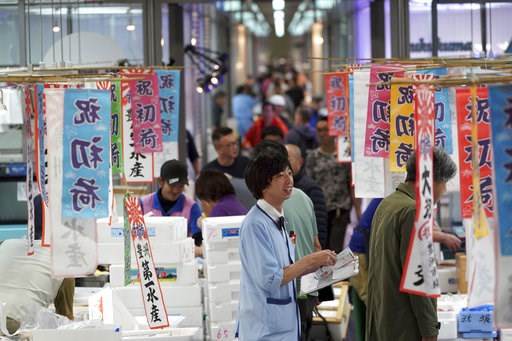 (AP Photo/Eugene Hoshiko). A worker of a wholesale market stands at the newly opened Toyosu Market, new site of Tokyo's fish market, in Tokyo Thursday, Oct. 11, 2018. Thursday was the first day of business at the new facility on Tokyo's waterfront call...