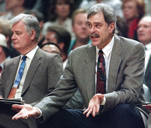 (AP Photo/Fred Jewell, File). FILE - In this May 18, 1995, file photo, Chicago Bulls coach Phil Jackson argues a call against his team, as he sits next to assistant coach Tex Winter during the second quarter of an NBA basketball playoff game against th...