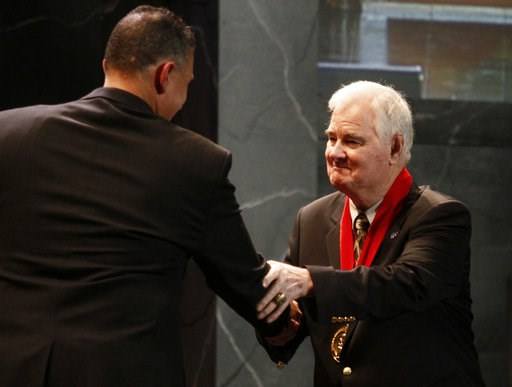 (AP Photo/Ed Zurga, File). FILE - In this Nov. 21, 2010, file photo, former Kansas State basketball coach Tex Winter, right, shakes hands with Kansas State coach Frank Martin during the former's induction into the National Collegiate Basketball Hall of...