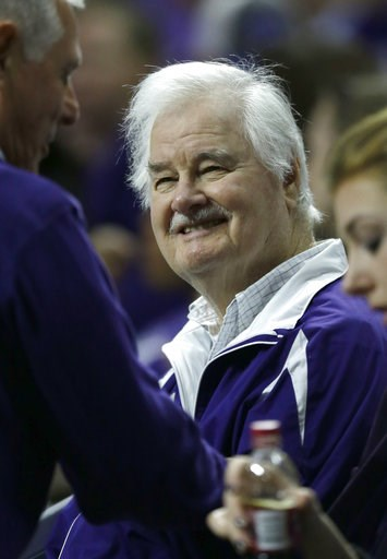 (AP Photo/Orlin Wagner, File). FILE - In this Jan. 24, 2015, file photo, Former Kansas State basketball coach Tex Winter smiles when greeted in the crowd during the first half of the team's NCAA college basketball game against Oklahoma State in Manhatt...