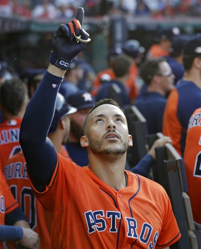 (AP Photo/David Dermer). Houston Astros' Carlos Correa celebrates in the dugout after hitting a three-run home run in the eighth inning during Game 3 of a baseball American League Division Series against the Cleveland Indians, Monday, Oct. 8, 2018, in ...