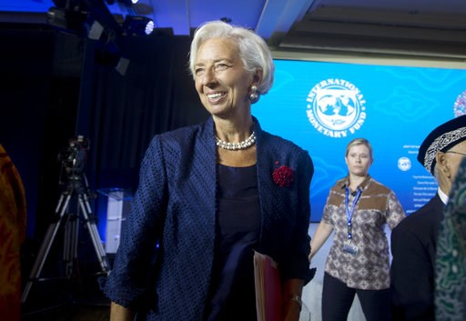 (AP Photo/Firdia Lisnawati). Managing Director of International Monetary Fund (IMF) Christine Lagarde, left, leaves after a press conference ahead of the annual meetings of the IMF and World Bank  in Bali, Indonesia Thursday, Oct. 11, 2018.