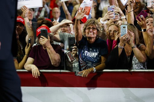 (AP Photo/Evan Vucci). Supporters of President Donald Trump cheer as he arrives to speak at a campaign rally at Erie Insurance Arena, Wednesday, Oct. 10, 2018, in Erie, Pa. As Hurricane Michael pounded the Southeast on Wednesday, Trump took shelter at ...