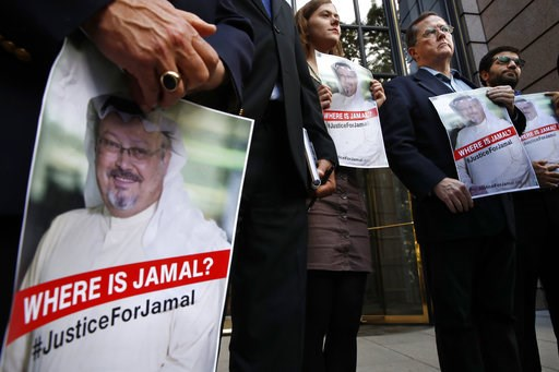 (AP Photo/Jacquelyn Martin). Alyssa Edling, center, and Thomas Malia, second from right, both with PEN America, join others as they hold signs of missing journalist Jamal Khashoggi, during a news conference about his disappearance in Saudi Arabia, Wedn...