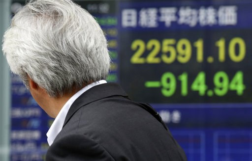 (AP Photo/Koji Sasahara). A man looks at an electronic stock board of a securities firm in Tokyo, Thursday, Oct. 11, 2018. Asian markets tumbled on Thursday, after Wall Street slumped on a heavy selling of technology and internet stocks. Japan's benchm...