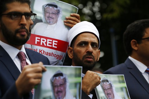 (AP Photo/Lefteris Pitarakis, File). FILE - In this Monday, Oct. 8, 2018 file photo, members of the Turkish-Arab Journalist Association hold posters with photos of missing Saudi writer Jamal Khashoggi, as they hold a protest near the Saudi Arabia consu...