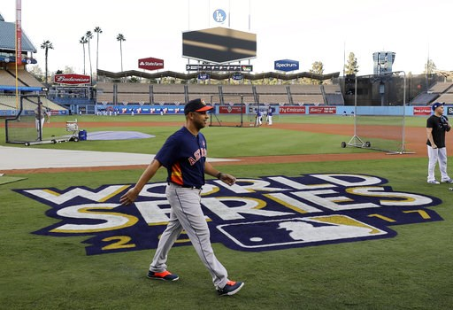 (AP Photo/David J. Phillip, file). FILE - In this Oct. 23, 2017 file photo, Houston Astros bench coach Alex Cora walks across the field in Los Angeles during media day for baseball's World Series against the Los Angeles Dodgers. Current Boston Red Sox ...