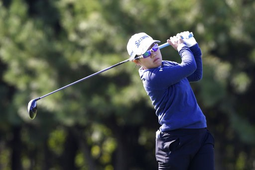 (AP Photo/Ahn Young-joon). Nasa Hataoka of Japan watches her shot on the second hole during the first round of the LPGA KEB Hana Bank Championship at Sky72 Golf Club in Incheon, South Korea, Thursday, Oct. 11, 2018.