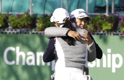 (AP Photo/Ahn Young-joon). Nasa Hataoka, right, of Japan hugs Minjee Lee of Australia after finishing the first round of the LPGA KEB Hana Bank Championship at Sky72 Golf Club in Incheon, South Korea, Thursday, Oct. 11, 2018.