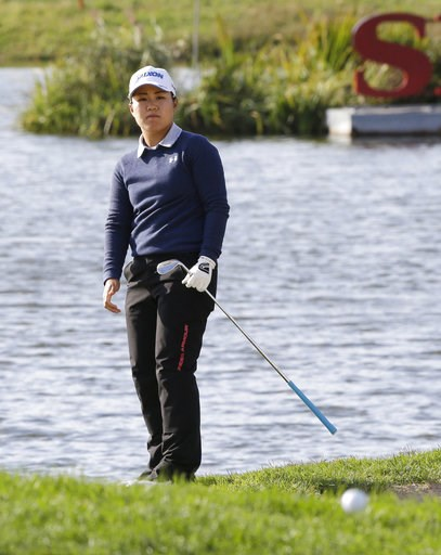 (AP Photo/Ahn Young-joon). Nasa Hataoka of Japan watches the ball on the 18th hole during the first round of the LPGA KEB Hana Bank Championship at Sky72 Golf Club in Incheon, South Korea, Thursday, Oct. 11, 2018.