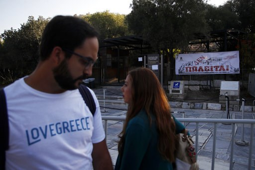 (AP Photo/Thanassis Stavrakis). Tourists pass outside the closed Acropolis ancient site in Athens, Thursday, Oct. 11, 2018 during a 24-hour strike called by a Greek union representing staff at the country's ancient site. The union accused the Greek gov...