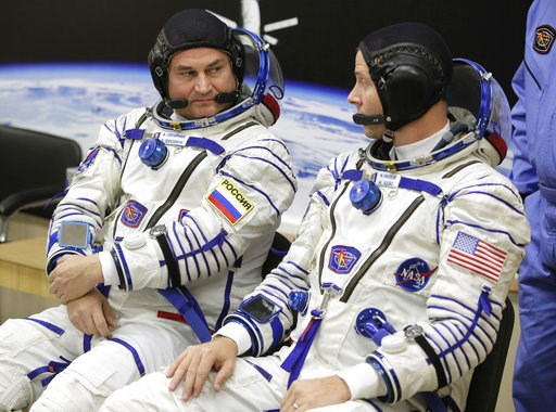 (AP Photo/Dmitri Lovetsky). U.S. astronaut Nick Hague, right and Russian cosmonaut Alexey Ovchinin, member of the main crew of the expedition to the International Space Station (ISS), speak prior to the launch of Soyuz MS-10 space ship at the Russian l...