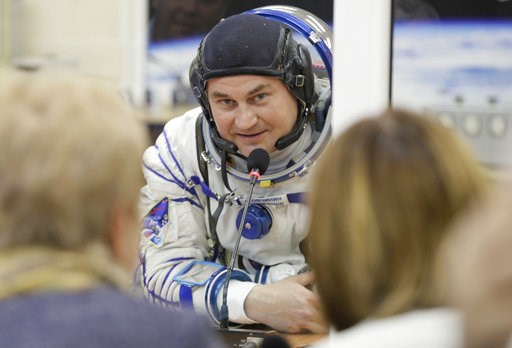 (AP Photo/Dmitri Lovetsky). Russian cosmonaut Alexey Ovchinin, a member of the main crew of the expedition to the International Space Station (ISS), speaks with his relatives through a safety glass prior to the launch of Soyuz MS-10 space ship at the R...