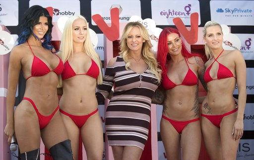 (Ralf Hirschberger/dpa via AP). Adult film actress Stormy Daniels, 3rd left, attends the opening of the adult entertainment fair 'Venus' in Berlin, Germany, Thursday, Oct. 11, 2018.