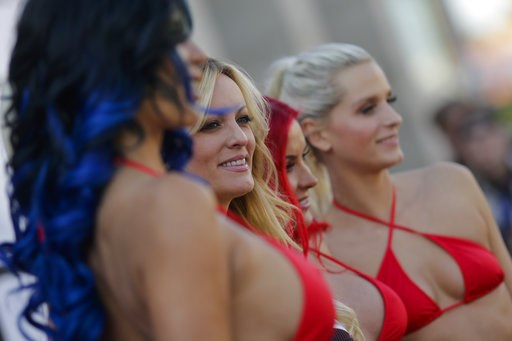 (AP Photo/Markus Schreiber). Adult film actress Stormy Daniels, second from left, attends the opening of the adult entertainment fair 'Venus' in Berlin, Germany, Thursday, Oct. 11, 2018.