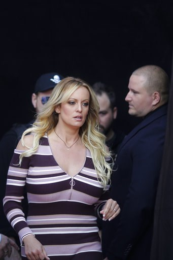 (AP Photo/Markus Schreiber). Adult film actress Stormy Daniels, front, arrives for the opening of the adult entertainment fair 'Venus' in Berlin, Germany, Thursday, Oct. 11, 2018.