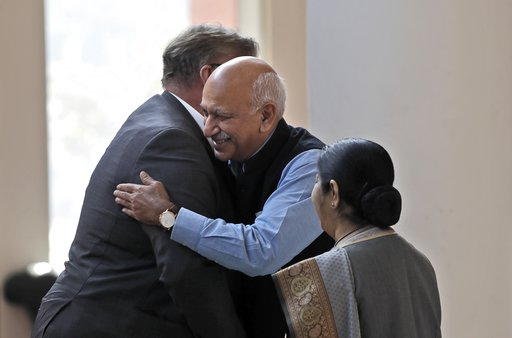 (AP Photo/Manish Swarup, File). FILE - In this Nov. 24, 2017 file photo, Indian Junior Foreign Minister M.J. Akbar, center, hugs Finland's Foreign Minister Timo Soini in New Delhi, India. A complaint by a retired Bollywood actress living in the United ...