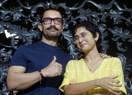 (AP Photo/Rajanish Kakade, File). FILE - In this March 14, 2018 file photo, Bollywood actor Aamir Khan stands wife his wife Kiran Rao at their residence in Mumbai, India. On October 10, actor and heavyweight Bollywood producer Aamir Khan and his wife K...