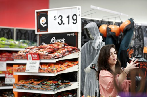 (AP Photo/Brynn Anderson, File). FILE- In this Oct. 3, 2018, file photo Sophia Narvaez, looks at Halloween decorations at a Target department store in Pembroke Pines, Fla. On Thursday, Oct. 11, the Labor Department reports on U.S. consumer prices for S...