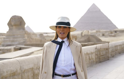 (AP Photo/Carolyn Kaster). U.S. first lady Melania Trump talks to media as she visits the ancient statue of Sphinx, with the body of a lion and a human head, at the historic Giza Pyramids site near Cairo, Egypt on Saturday, Oct. 6, 2018. Trump is visit...