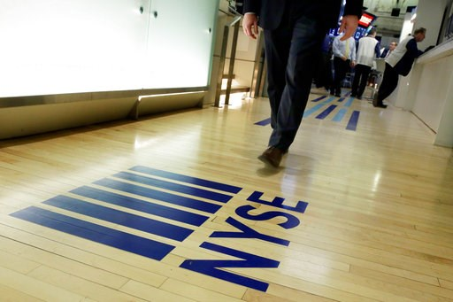 (AP Photo/Richard Drew, File). FILE- In this April 5, 2018, file photo a NYSE logo adorns the entrance to the trading floor the New York Stock Exchange. The U.S. stock market opens at 9:30 a.m. EDT on Thursday, Oct. 11.