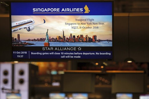 (AP Photo/Wong Maye-E). A screen advertising Singapore Airline's inaugural non-stop flight to New York is flashed on a screen at Changi International Airport on Thursday, Oct. 11, 2018, in Singapore. The world's longest flight is taking travelers from ...