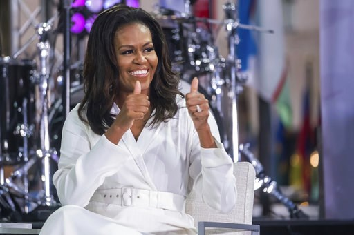 """(Photo by Charles Sykes/Invision/AP). Michelle Obama participates in the International Day of the Girl on NBC's """"Today"""" show at Rockefeller Plaza on Thursday, Oct. 11, 2018, in New York."""