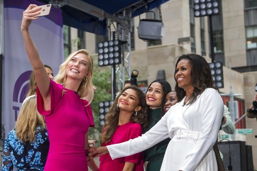 "(Photo by Charles Sykes/Invision/AP). Karlie Kloss, from left, Zendaya, Freida Pinto, Monica Nyiraguhabwa and Michelle Obama participate in the International Day of the Girl on NBC's ""Today"" show at Rockefeller Plaza on Thursday, Oct. 11, 2018, in New ..."