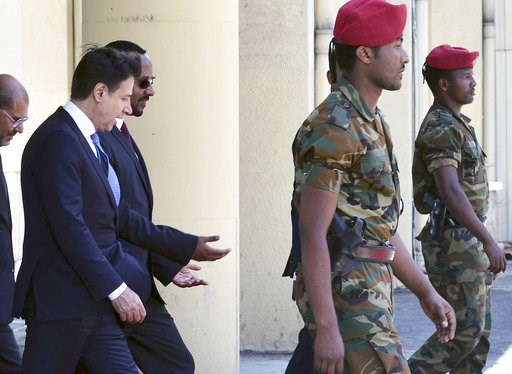(AP Photo). Italy's Prime Minister Giuseppe Conte, left, is welcomed by Ethiopia's Prime Minister Abiy Ahmed, second from left, upon his arrival at the airport in Addis Ababa, Ethiopia Thursday, Oct. 11, 2018. The two parties will have bilateral discus...