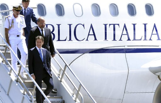 (AP Photo). Italy's Prime Minister Giuseppe Conte, foreground, arrives at the airport in Addis Ababa, Ethiopia Thursday, Oct. 11, 2018 for a bilateral visit to the country. The two parties will have bilateral discussions on trade, investment, and other...