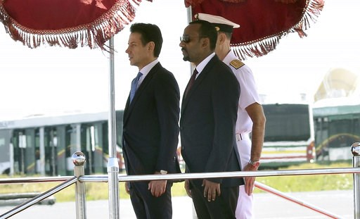 (AP Photo). Italian Premier Giuseppe Conte, left, and Ethiopian Prime Minister Abiy Ahmed Ali stand attention at they review the guard of honor, in Addis Ababa, Ethiopia on the occasion of an official visit, Thursday Oct. 11, 2018.