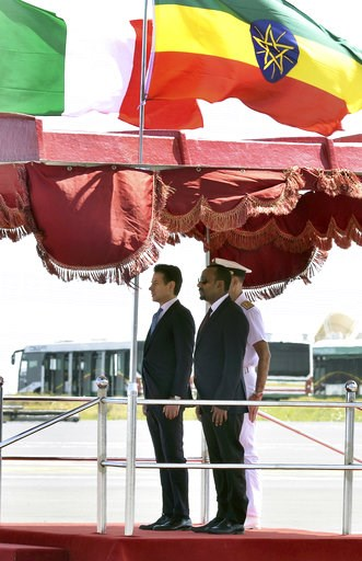 (AP Photo). Italy's Prime Minister Giuseppe Conte, left, stands by Ethiopia's Prime Minister Abiy Ahmed during a welome ceremonh upon his arrival at the airport in Addis Ababa, Ethiopia Thursday, Oct. 11, 2018. The two parties will have bilateral discu...