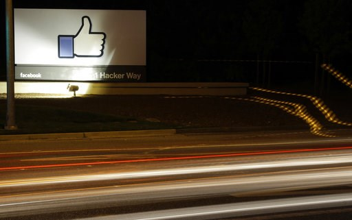 "(AP Photo/Marcio Jose Sanchez, File). FILE - In this June 7, 2013, file photo, the Facebook ""like"" symbol is on display on a sign outside the company's headquarters in Menlo Park, Calif. Facebook says it has purged more than 800 U.S. pages and accounts..."