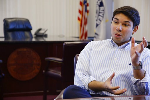 (AP Photo/Stephan Savoia, File). FILE- In this Jan. 6, 2016, file photo newly elected Fall River Mayor Jasiel Correia talks in his city hall office in Fall River, Mass. A Massachusetts mayor was arrested Thursday, Oct. 11, 2018, and charged with defrau...