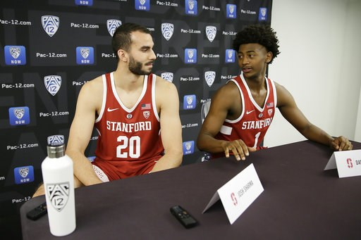 (AP Photo/Eric Risberg). Stanford's Josh Sharma, left, and Daejon Davis, right, talk with each other during the Pac-12 NCAA college basketball media day Thursday, Oct. 11, 2018, in San Francisco.