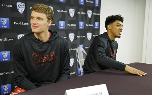(AP Photo/Eric Risberg). Utah's Jayce Johnson, left, and Sedrick Barefield, right, answer questions during the Pac-12 NCAA college basketball media day Thursday, Oct. 11, 2018, in San Francisco.