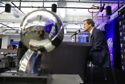 (AP Photo/Eric Risberg). With the 2019 Pac-12 tournament championship trophy in the foreground, Oregon head coach Dale Altman answers questions during the Pac-12 NCAA college basketball media day Thursday, Oct. 11, 2018, in San Francisco.