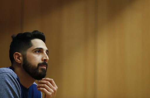 (AP Photo/Jeff Roberson). Milwaukee Brewers starting pitcher Gio Gonzalez answers questions at a news conference for Game 1 of the National League Championship Series baseball game against the Los Angeles Dodgers Thursday, Oct. 11, 2018, in Milwaukee.