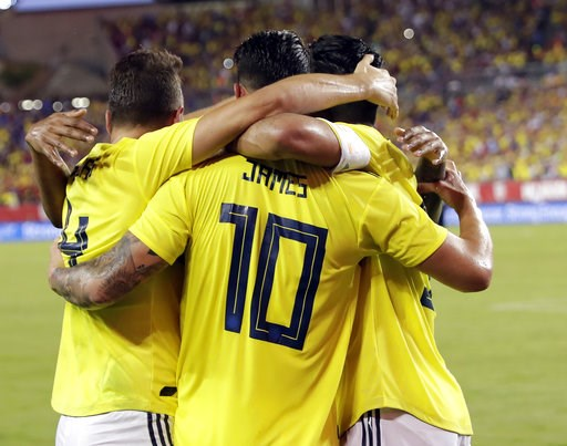 (AP Photo/John Raoux). Colombia's James Rodriguez (10) celebrates his goal against the United States with teammates during the first half of an international friendly soccer match Thursday, Oct. 11, 2018, in Tampa, Fla.