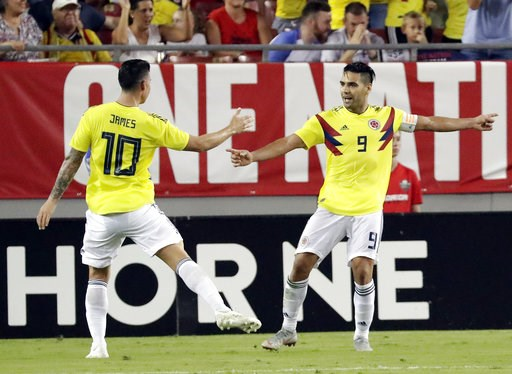 (AP Photo/John Raoux). Colombia's Radamel Falcao (9) celebrates his goal against the United States with teammate James Rodriguez (10) during the second half of an international friendly soccer match Thursday, Oct. 11, 2018, in Tampa, Fla.