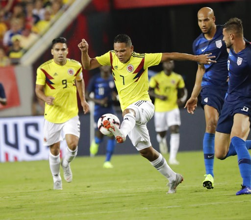 (AP Photo/John Raoux). Colombia's Carlos Bacca (7) moves the ball away from United States' John Brooks, center, and Matt Miazga, right, during the first half of an international friendly soccer match Thursday, Oct. 11, 2018, in Tampa, Fla.
