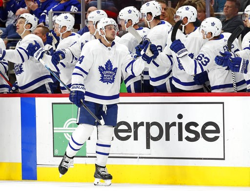(AP Photo/Paul Sancya). Toronto Maple Leafs center Auston Matthews (34) celebrates his goal during the second period of an NHL hockey game against the Detroit Red Wings on Thursday, Oct. 11, 2018, in Detroit.