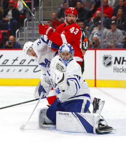 (AP Photo/Paul Sancya). Toronto Maple Leafs goaltender Frederik Andersen (31) stops a Detroit Red Wings shot during the second period of an NHL hockey game Thursday, Oct. 11, 2018, in Detroit.