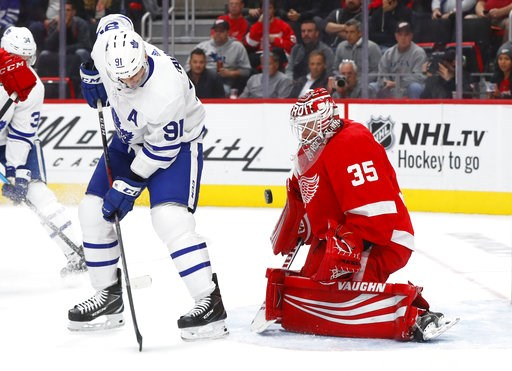 (AP Photo/Paul Sancya). Detroit Red Wings goaltender Jimmy Howard (35) stops a deflection by Toronto Maple Leafs center John Tavares (91) during the first period of an NHL hockey game Thursday, Oct. 11, 2018, in Detroit.