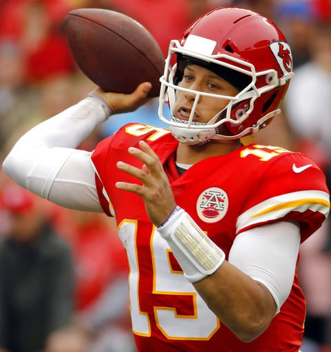(AP Photo/Charlie Riedel, File). FILE - In this Oct. 7, 2018, file photo, Kansas City Chiefs quarterback Patrick Mahomes (15) throws a pass during the first half of an NFL football game against the Jacksonville Jaguars, in Kansas City, Mo. New England ...