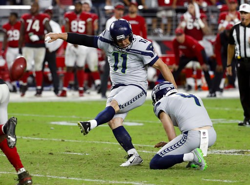 (AP Photo/Rick Scuteri, File). FILE - In this Sunday, Sept. 30, 2018, file photo, Seattle Seahawks kicker Sebastian Janikowski (11) kicks the game-winning field goal as punter Michael Dickson (4) holds during the second half of an NFL football game aga...